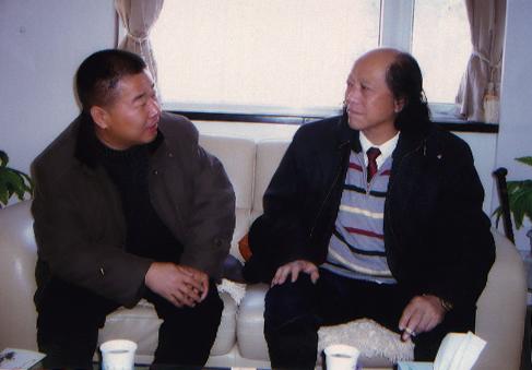 2007年在北京12中,北京中国书画协会常务副会长兼秘书长金明先生与图片